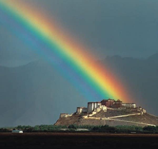 Galen Rowell - Rainbow over Potala Palace [Landscape Photographers]
